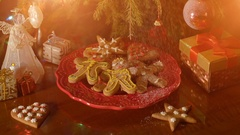 Christmas concept with gingerbread man cookie on red plate Stock Footage