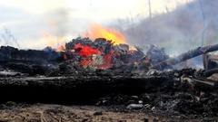 Smoke from the fire spread along the ground Stock Footage