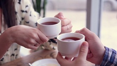 Happy loving couple in cafe drinking tea. First date Stock Footage