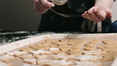 Person decorating cookies with toppings Stock Footage