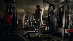 Girl doing squatting with barbell in the gym. Stock Footage