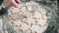 Person putting raw cookies to flour Stock Footage