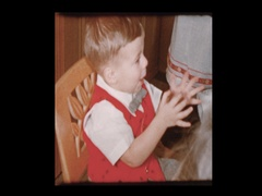 3 year old Birthday boy claps at birthday party Stock Footage