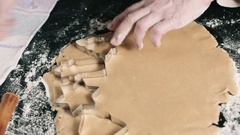 Cook cut out dough for cookies Stock Footage