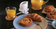 Dolly sliding view of a French breakfast with pastries, orange juice and coffee Stock Footage