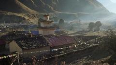 Sunrise shot of monastery in Nepali village. UHD, 4K Stock Footage