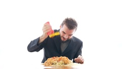 Nasty businessman eating pasta with ketchup Stock Footage