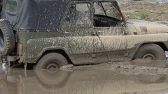 Offroad car stuck in the mud Stock Footage