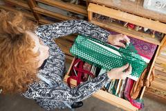 Owner of small fashion business working in material storeroom Kuvituskuvat