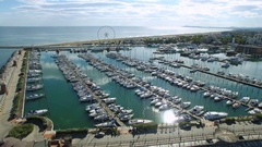 A beautiful Bay to Rimini with a floating yacht and Ferris wheel, aerial view Stock Footage