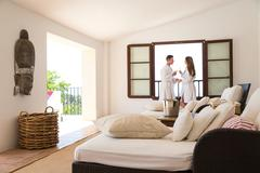 Couple making a champagne toast in boutique hotel suite, Majorca, Spain Stock Photos