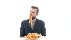 Disgusting businessman eating pasta Stock Footage