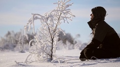 A man admires the tree in the snow Stock Footage