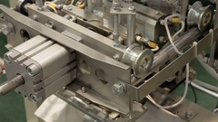 Factory packing machine with pipes and rolls Stock Footage