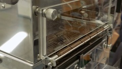 Product conveyor line on a chocolate factory Stock Footage