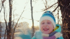 Girl five years makes a funny face, looking at the camera, laughing. Winter joy Stock Footage