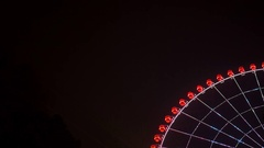 Ferris wheel spinning at night. The magical attraction. Asia Stock Footage