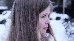 Sunny Winter Joyful Girl sitting in winter park. Snow Stock Footage