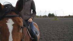 Young man horseback riding outdoor. Love for animals. Slow motion Stock Footage