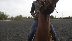 Young man horseback riding outdoor. Stallion close up. Slow motion Stock Footage