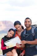 Girl and adult hikers looking at map, Sedona, Arizona, USA Stock Photos