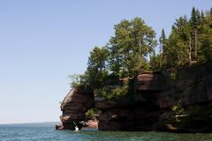 Man kayaking on Lake Superior, Apostle Islands National Lakeshore, Wisconsin, Stock Photos