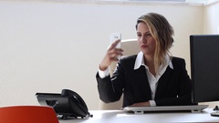 Office woman taking a selfie during working hours Stock Footage