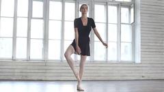 Ballet dancer raises a leg up Stock Footage
