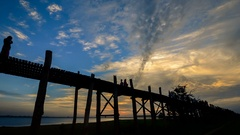 U Bein bridge in Myanmar silhouettes of people timelapse at sunset.  Stock Footage