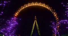 Time lapse view of a giant ferry wheel floodlit at night Stock Footage