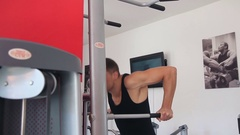 The man pushed on the bar at the gym Stock Footage