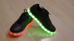 Black child shoes with blinking led sole Stock Footage