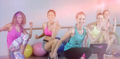 Group of women performing aerobics Stock Photos