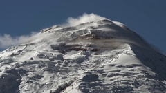 Clouds streaming over the glaciers on the summit of Cotopaxi Volcano Stock Footage