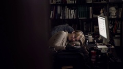 Girl lying at office desk with a tablet Stock Footage