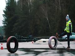 Man kicking tires on drift race track Stock Footage