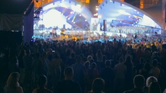 View from the high point on big crowd watching concert on arena at night Stock Footage