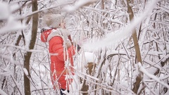 Girl with poor eyesight lost their way home in the winter forest Stock Footage