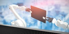 Composite image of digital generated image of robots holding computer tablet 3d Stock Illustration
