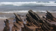 Small Rocks Formations on sandy Beach. Stock Footage