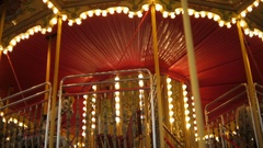 Beautiful illuminated carousel with marquee at night Stock Footage