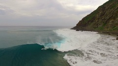 A surfer rides a giant wave. About nature, dominate nature, sports, risk Stock Footage