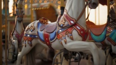 Beautiful colorful vintage carousel at amusement park Stock Footage