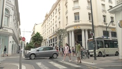 Street, people and cars. Shopping and visit landmarks. Stock Footage