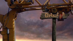 Sign direction DREAM - VISION with crane on front Stock Footage