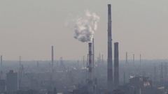 Smoke fumes from industrial chimney on the horizon Stock Footage