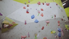 Indoor rock climbing wall in a sport facility where many practice to be fit Stock Footage