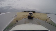 4x4 vehicles driving off Mantaray barge on Fraser Island Stock Footage