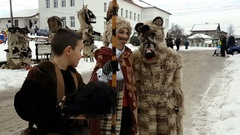 Bulgarian mummers children preparing for Surva festival Stock Footage