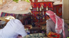 Bedouins and Arabs are Drinking Tea at Table in Egypt Stock Footage